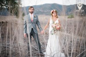 Ann Johnson Events Bohemian Santa Barbara Wedding Bride and Groom in a field
